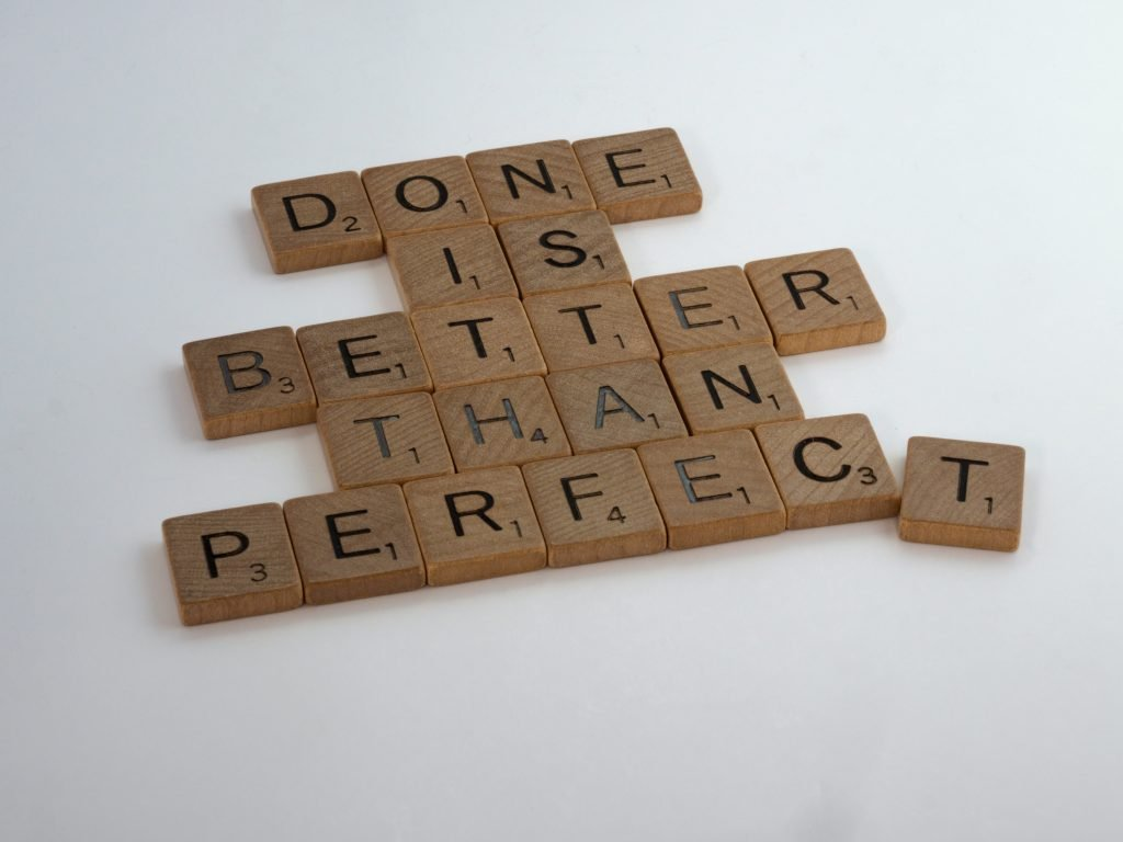 """""""Done is better than perfect spelled out"""" on Scrabble tiles"""